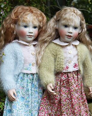Gorgeous fine cotton print skirts with pale pink embroidered, cotton dotted lawn blouses, over this there is a lovely angora knitted bolero. Each set is designed to fit our dolls with the Elsie or Robyn body.