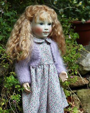 Sweet little cotton dress and knitted angora bolero.