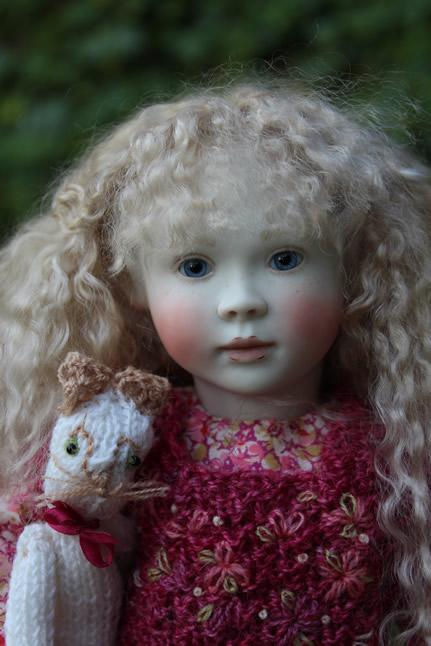 Minnie in her embroidered woollen top
